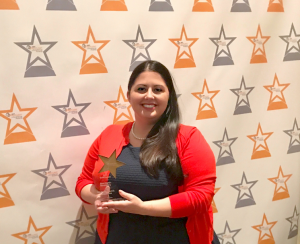"Southside Electric Cooperative Communications Specialist Lauren Irby accepts the 2017 Spotlight on Excellence Gold Award in Best Digital Storytelling for SEC's ""Day in the Life of a Lineman"" reality show."